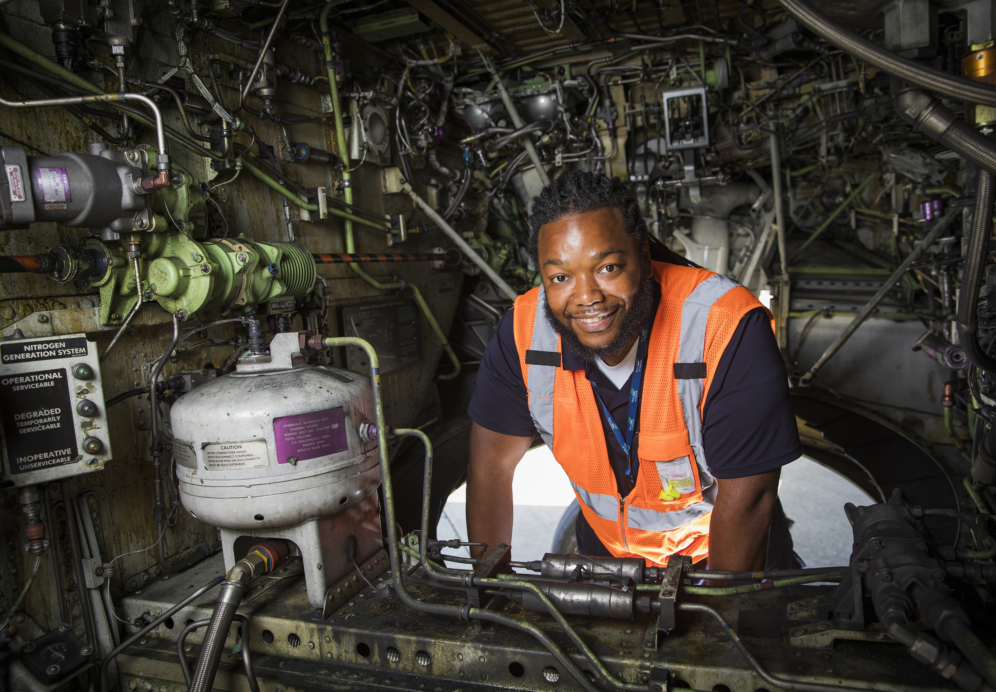 Smiling man surrounded by machinery