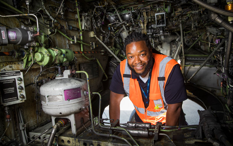 Man working inside a plane