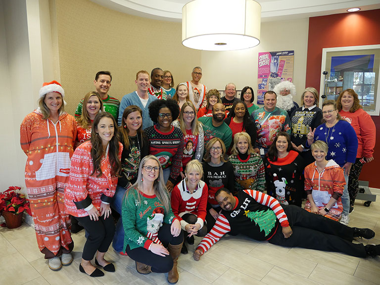 CEO, CFO and many more rocking Ugly Sweaters for our contest