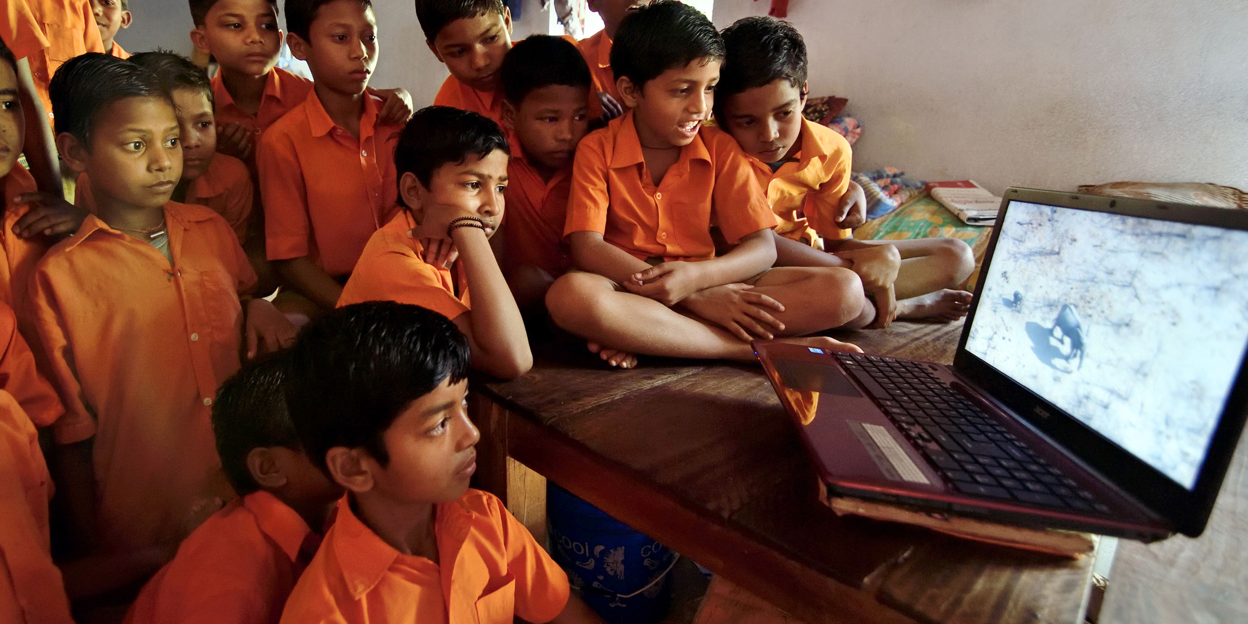 children watching a video on a laptop